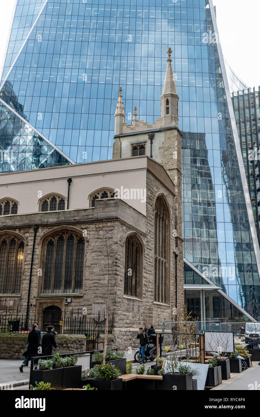 St Mary Axe in the City of London, where 16th century perpendicular architecture meets the 21st century angular design of  the 'Scalpel', WR Berkley T - Stock Image