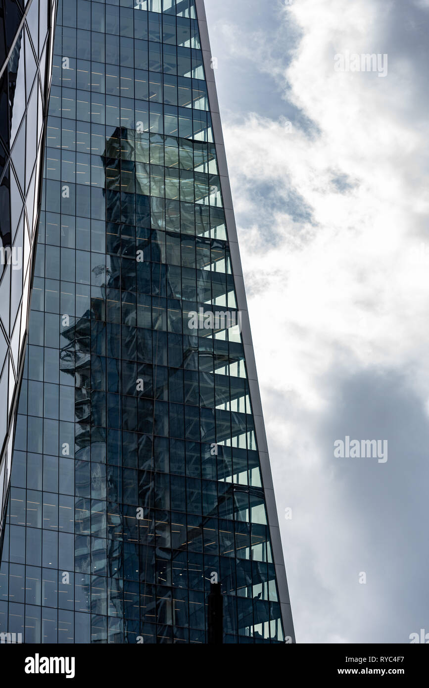 """The """"Cheesegrater"""" reflected in the """"Scalpel"""" with 30 St Mary Axe (""""Gherkin"""") building in the heart of London's financial centre. Stock Photo"""