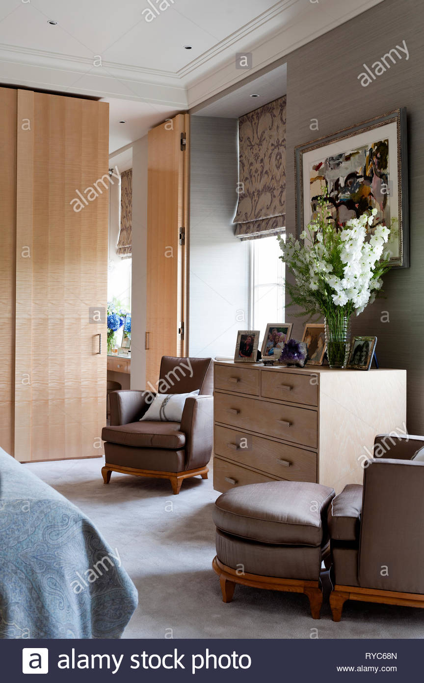 Armchairs by drawers in bedroom Stock Photo: 240598869 - Alamy