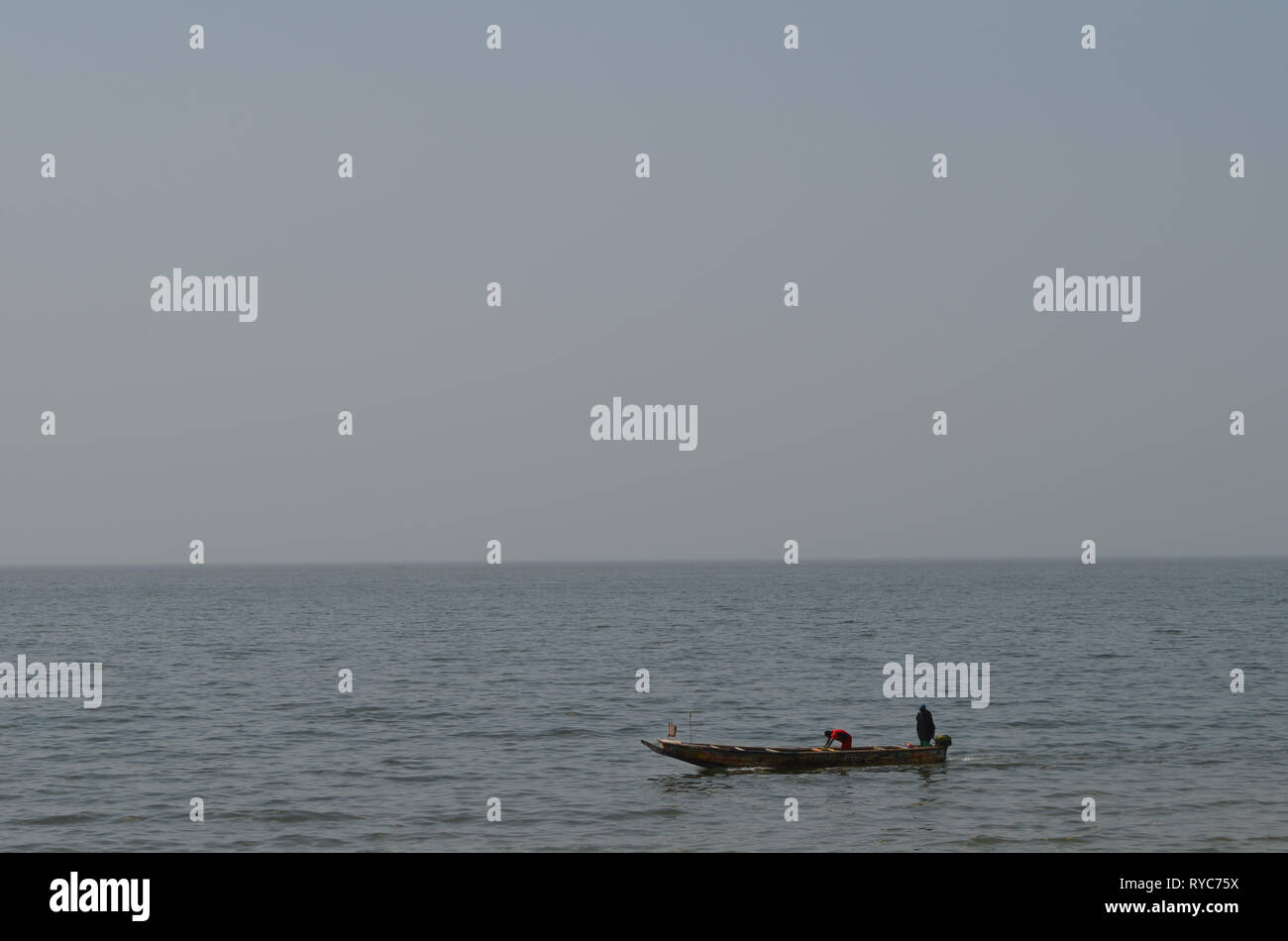 Artisanal pirogues at the beach of Djiffère, Senegal Stock Photo