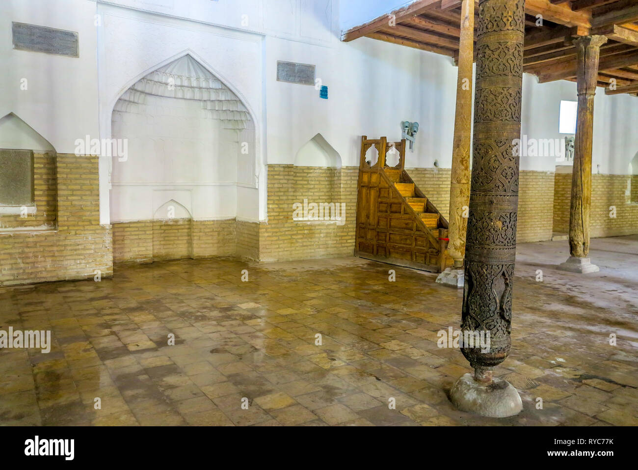 Khiva Old Town Juma Mosque Interior Wooden Columns at Prayers Hall with Mihrab - Stock Image