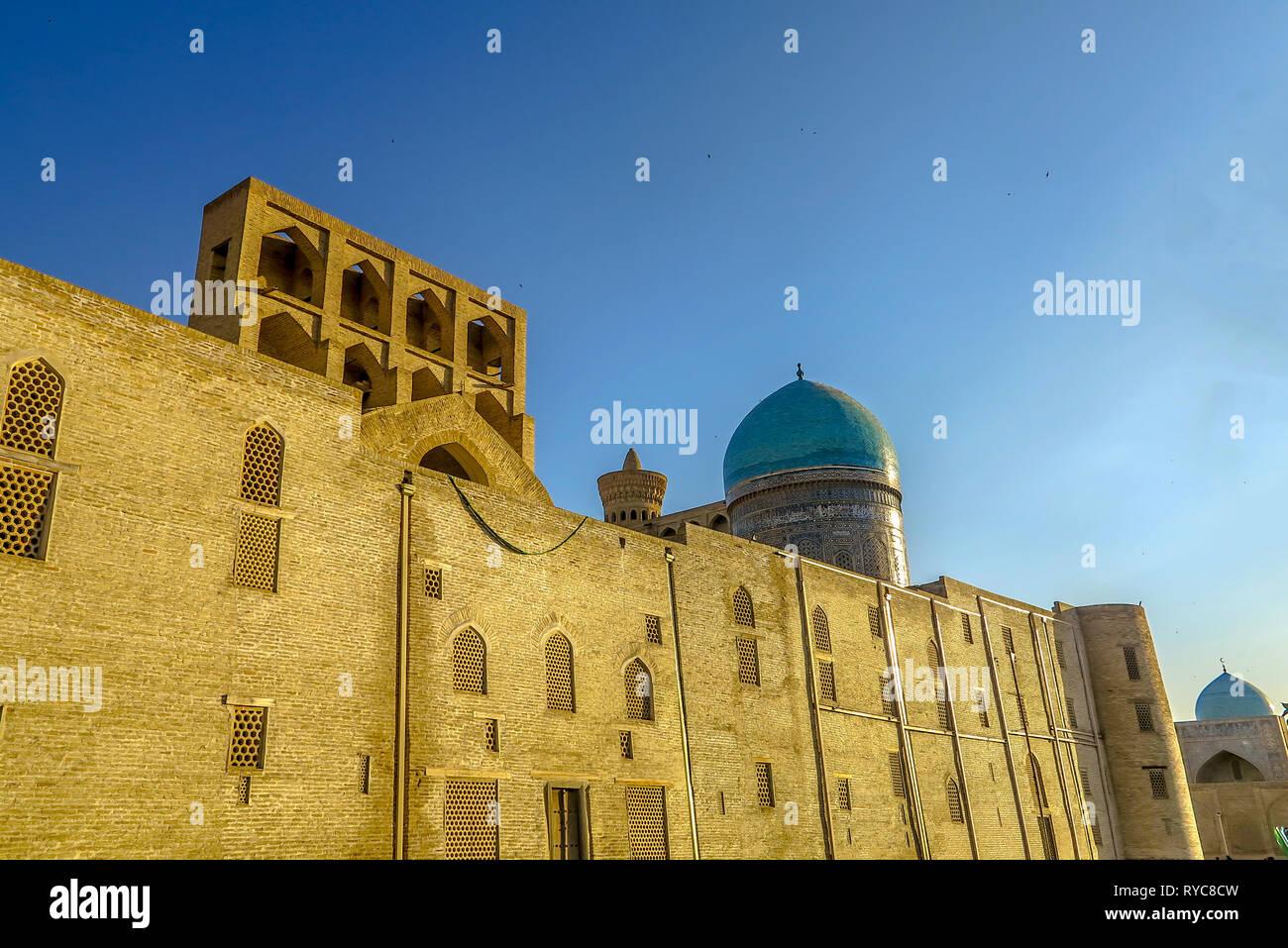 Bukhara Old City Arabian Miri Arab Madrasa Facade Walls Back View - Stock Image
