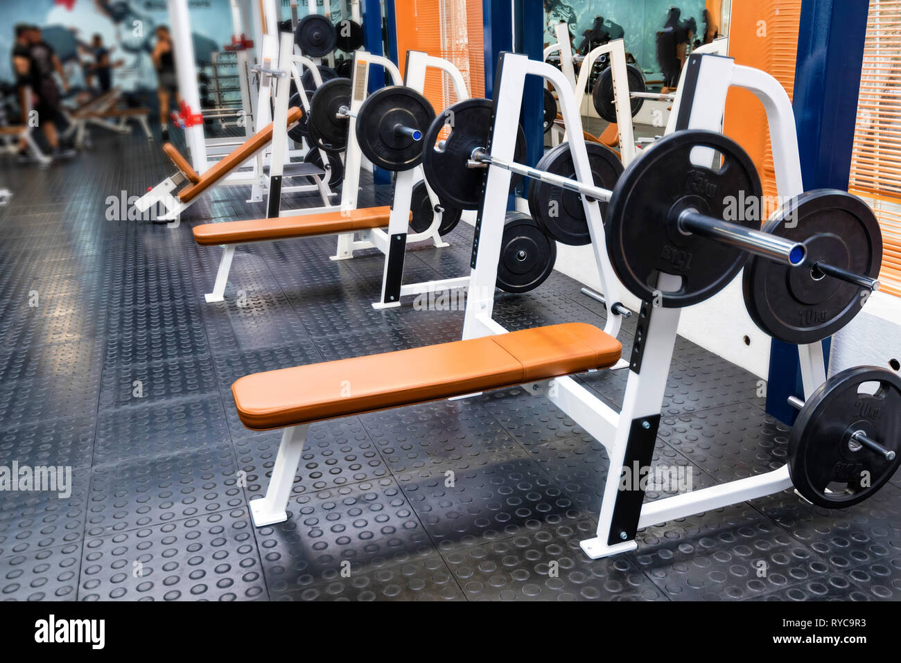 Empty bench press exercise machine in modern gym - Stock Image