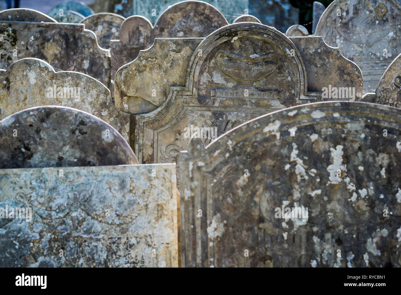 Old grave stones, one with the Latin inscription 'Memento mori' ('Remember the dead') - Stock Image