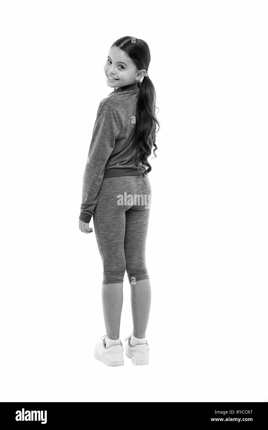 Working out with long hair. Sport for girls. Guidance on working out with long hair. Deal with long hair while exercising. Girl cute kid with long pon - Stock Image