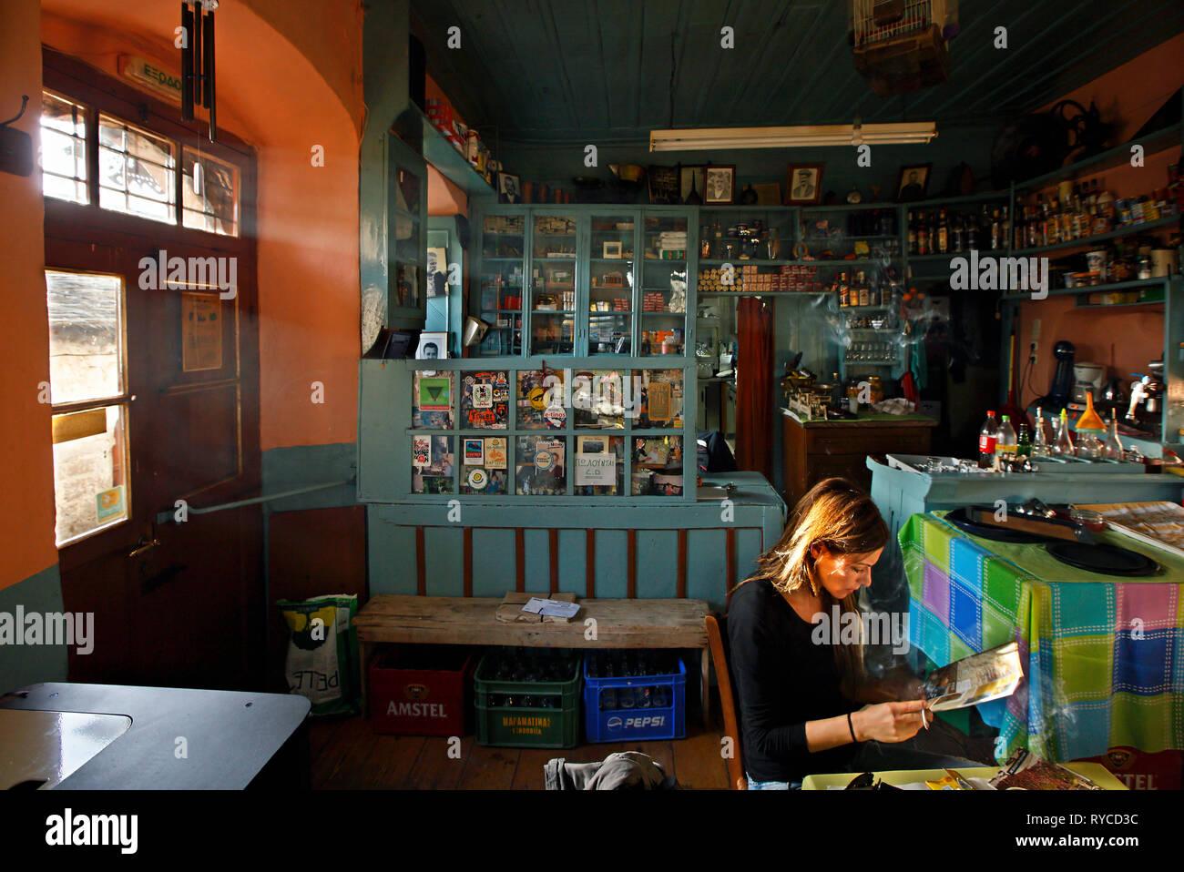 Inside 'Akanthos' kafeneio (traditional Greek coffee shop) in Kalarrytes village, Tzoumerka mountains, Ioannina, Epirus, Greece. - Stock Image