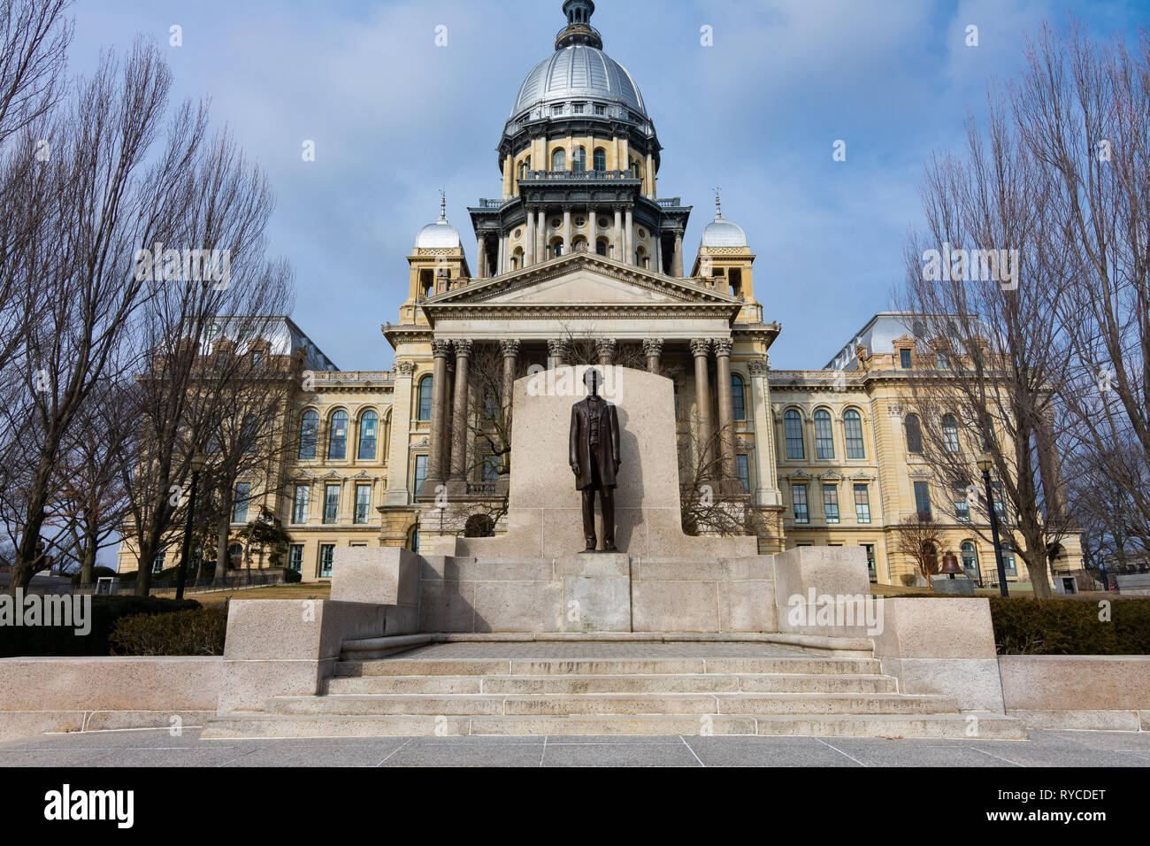 Statue of Abraham Lincoln and State Capitol Building on a Spring morning.  Springfield, Illinois, USA. Stock Photo