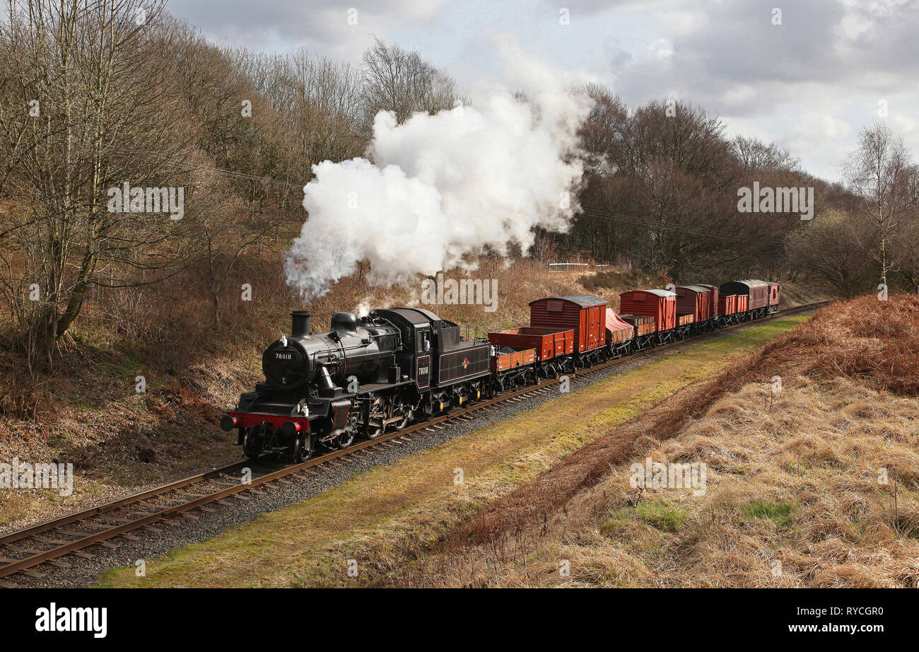 78018 heads past Little Burrs with a mixed freight on the East Lancs railway. Stock Photo