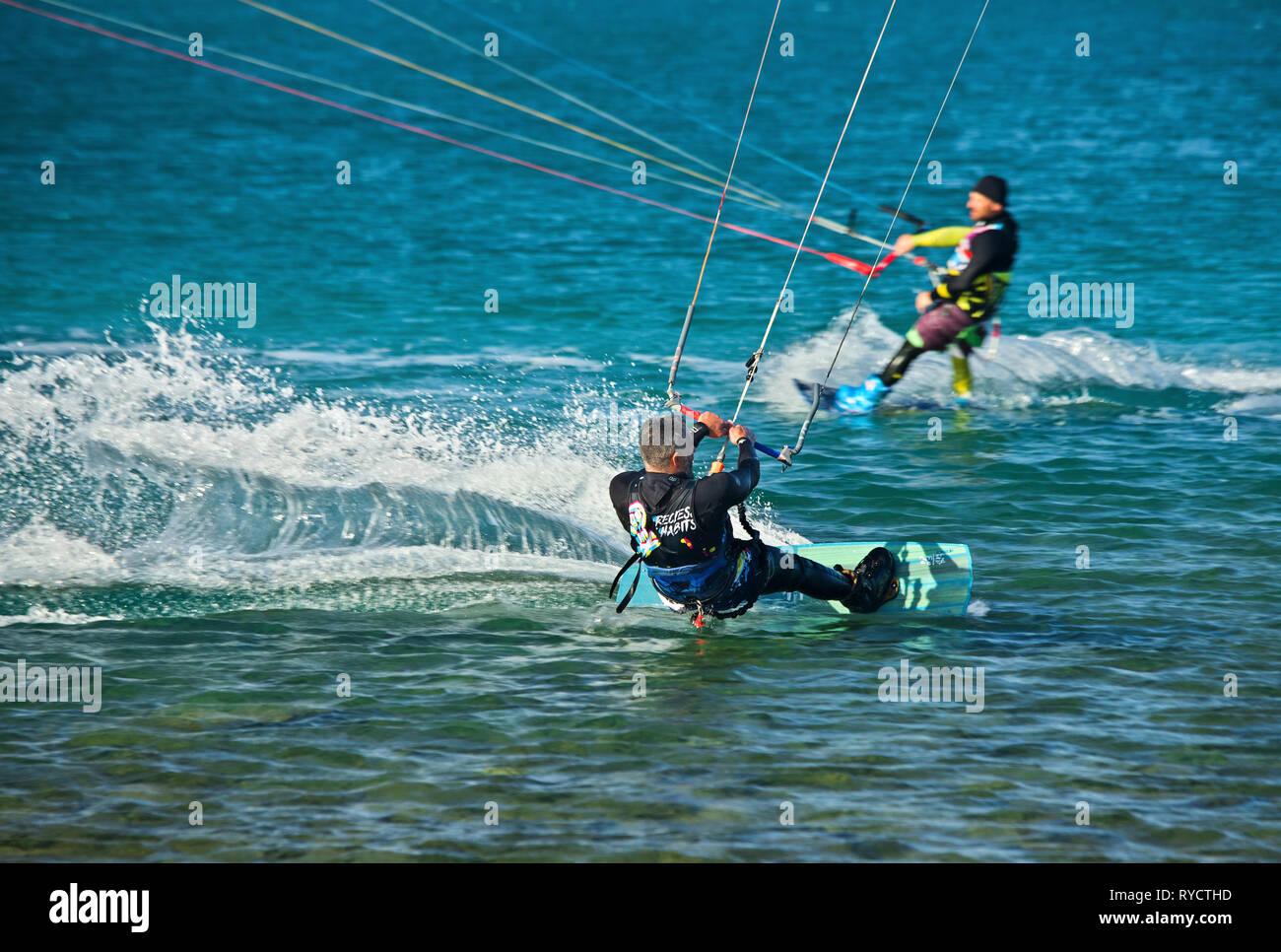 Kitesurfers at the bay of Mirabello, Elounda town, municipality of Agios Nikolaos, Lasithi, Crete. - Stock Image