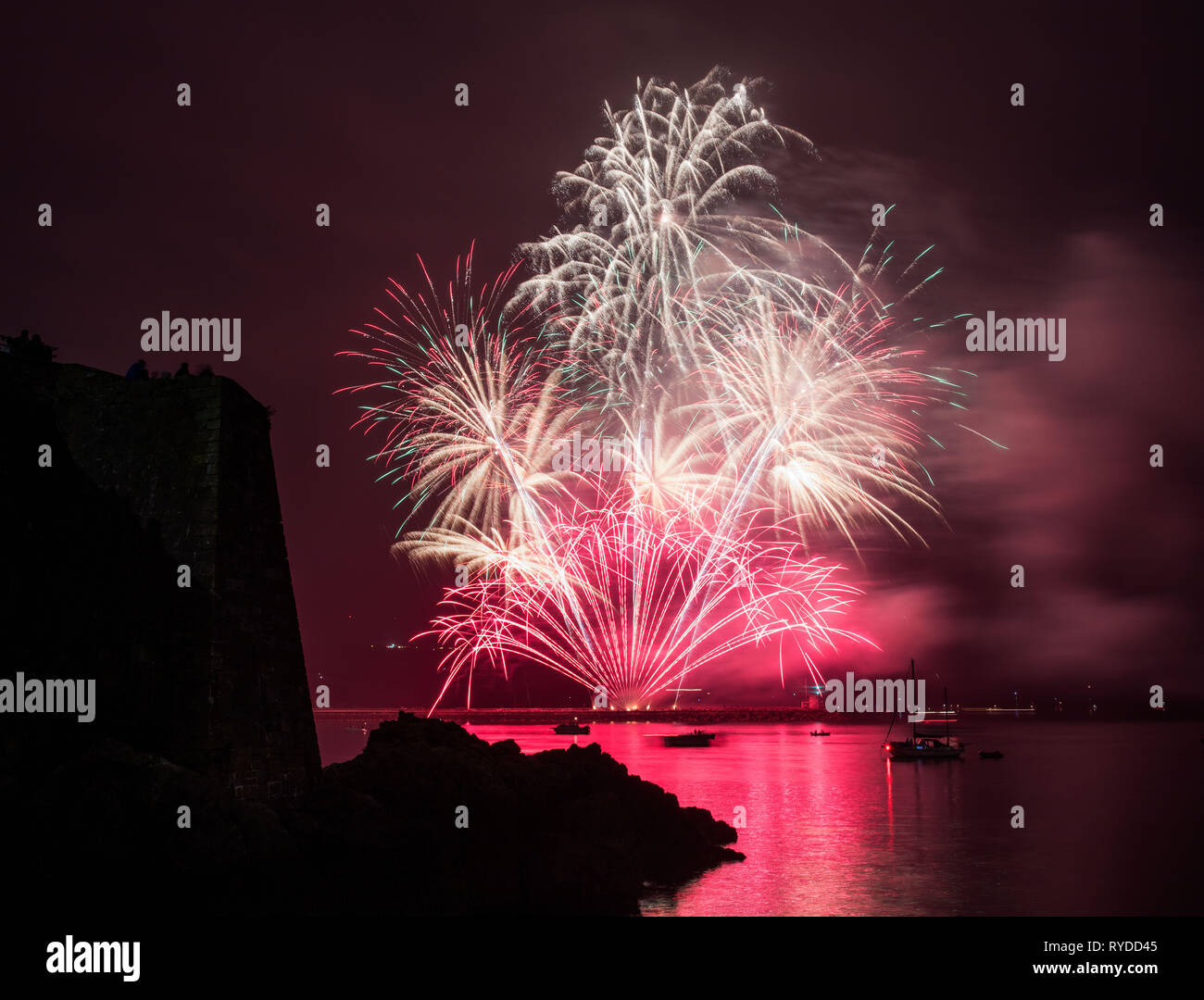 A firework going off at the National Firework Championships on Mount Batten. Stock Photo