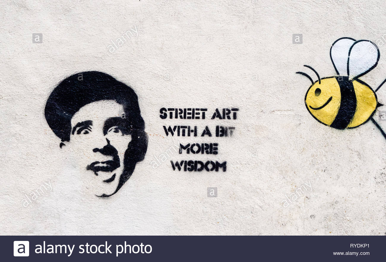 Humorous Bristol graffiti featuring comedian and film star Norman Wisdom and a bumblebee - Stock Image