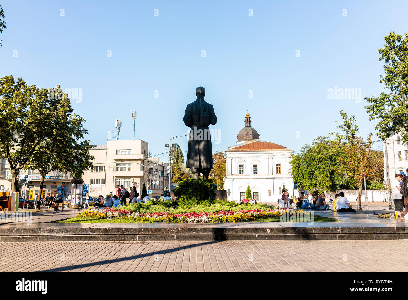 Kyiv, Ukraine - August 10, 2018: Sunny day in Kiev with Kontraktova Square park and people sitting on Skovoroda monument statue in summer outside - Stock Image