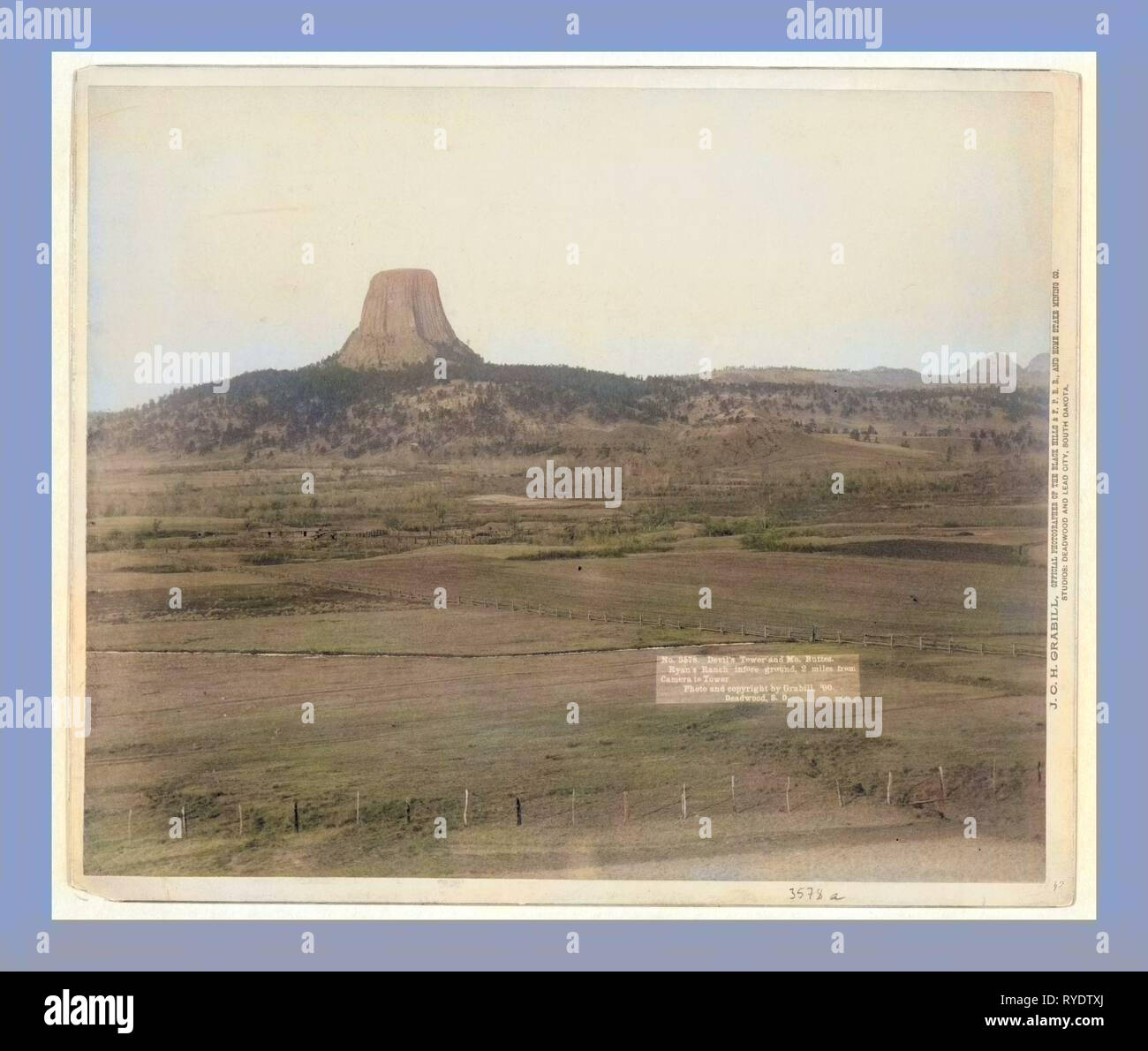 Devil's Tower and Mo. Buttes. Ryan's Ranch in Foreground, 2 Miles from Camera to Tower - Stock Image