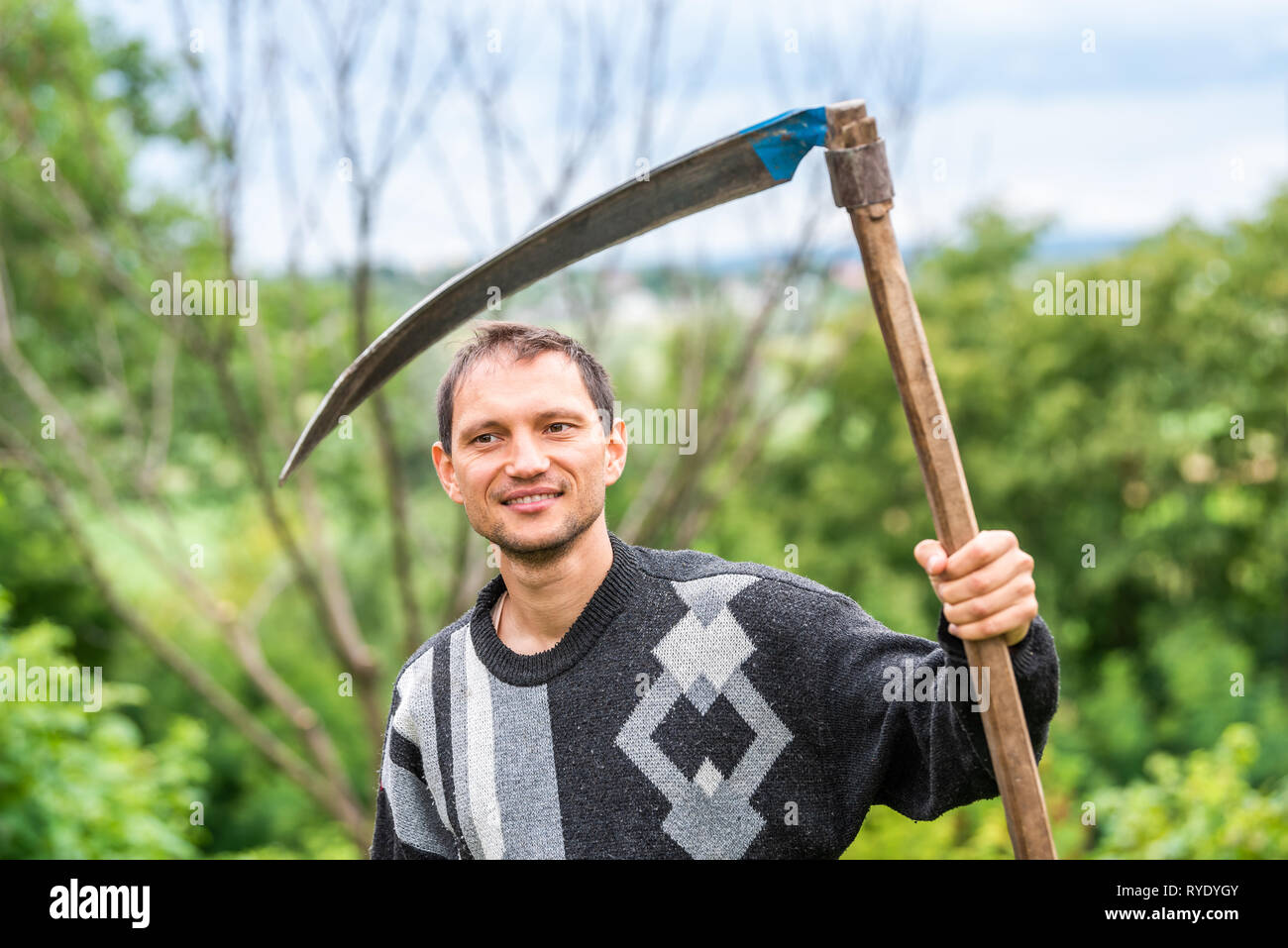 Happy young man closeup face farmer in garden standing with