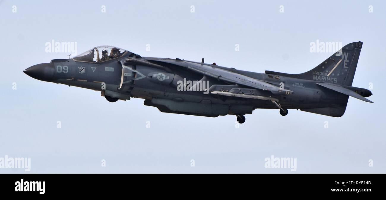 A Marine Corps AV-8B Harrier Jump Jet belonging to VMA-214 hovering at MCAS Yuma Stock Photo