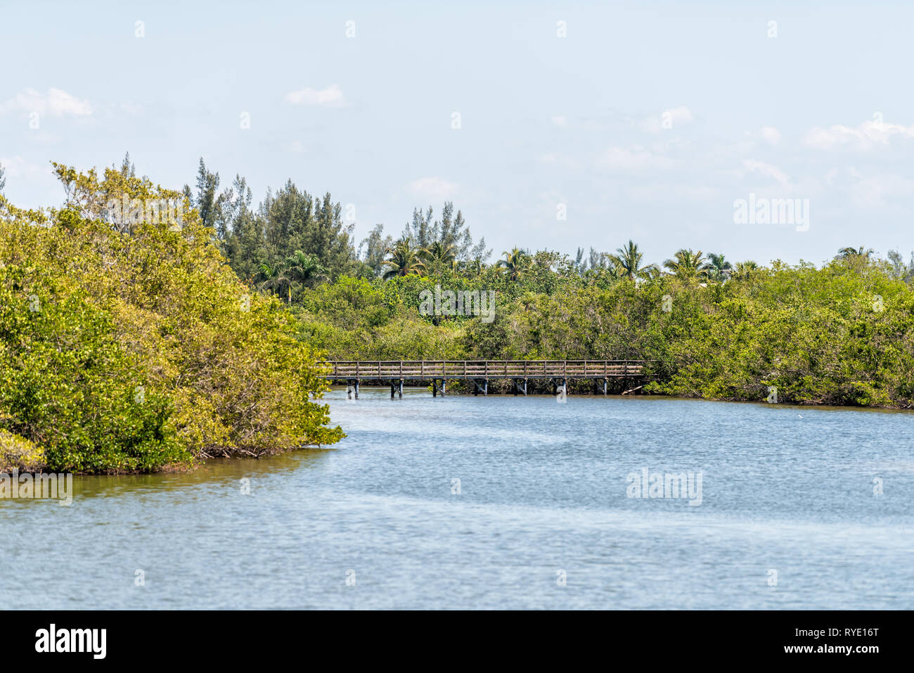 Sanibel Island, USA Bowman's beach with landscape view of Bayou from bridge and wooden boardwalk with nobody on river bay Stock Photo
