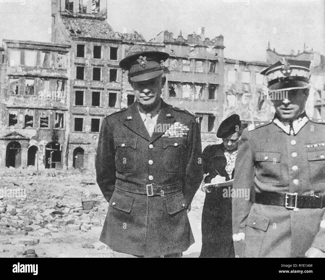 General Dwight Eisenhower during his visit in Warsaw, capital of Poland. Picture taken on the Old Town Square, destroyed in 1944 by German forces after supression of Warsaw Uprising (1944). Right, General Marian Spychalski. - Stock Image
