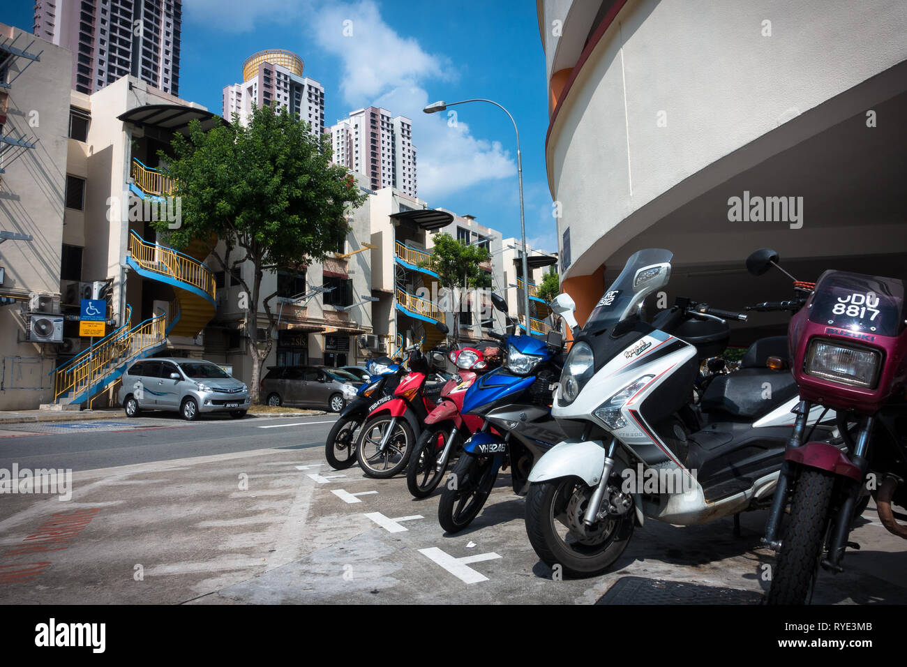 Scooters and Motorcycles parked at outdoor Toa Payoh Residences - Singapore - Stock Image
