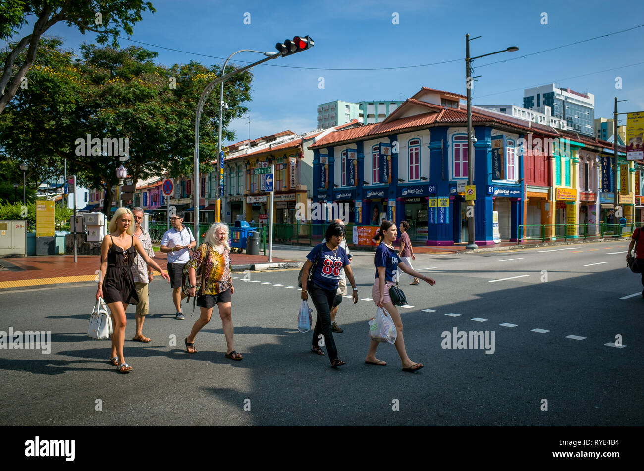 Foreign tourists crossing the street at Deepavali Festival, Little India - Singapore - Stock Image