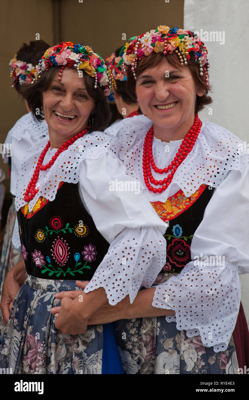 Two Polish women in traditional costumes and beaded headresses are folkloric dancers performing at a festival in Krakow, Poland Stock Photo