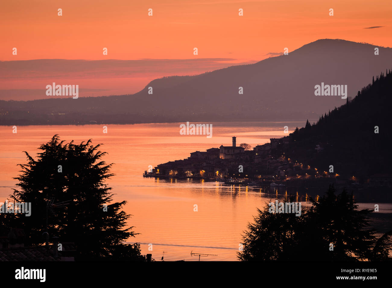 Lake Iseo with the town of Peschiera Maraglio on Monte Isola at dawn, Lombardy, Italy - Stock Image