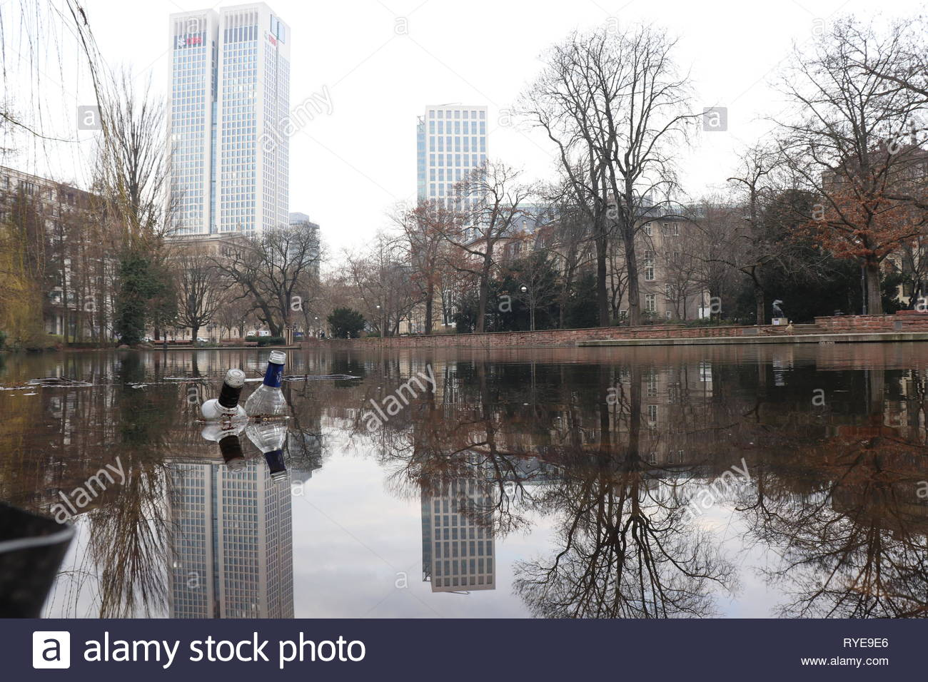 Alcohol bottles in the water at Bockenheimer Anlage, a pond in Frankfurt am Main in Germany Stock Photo
