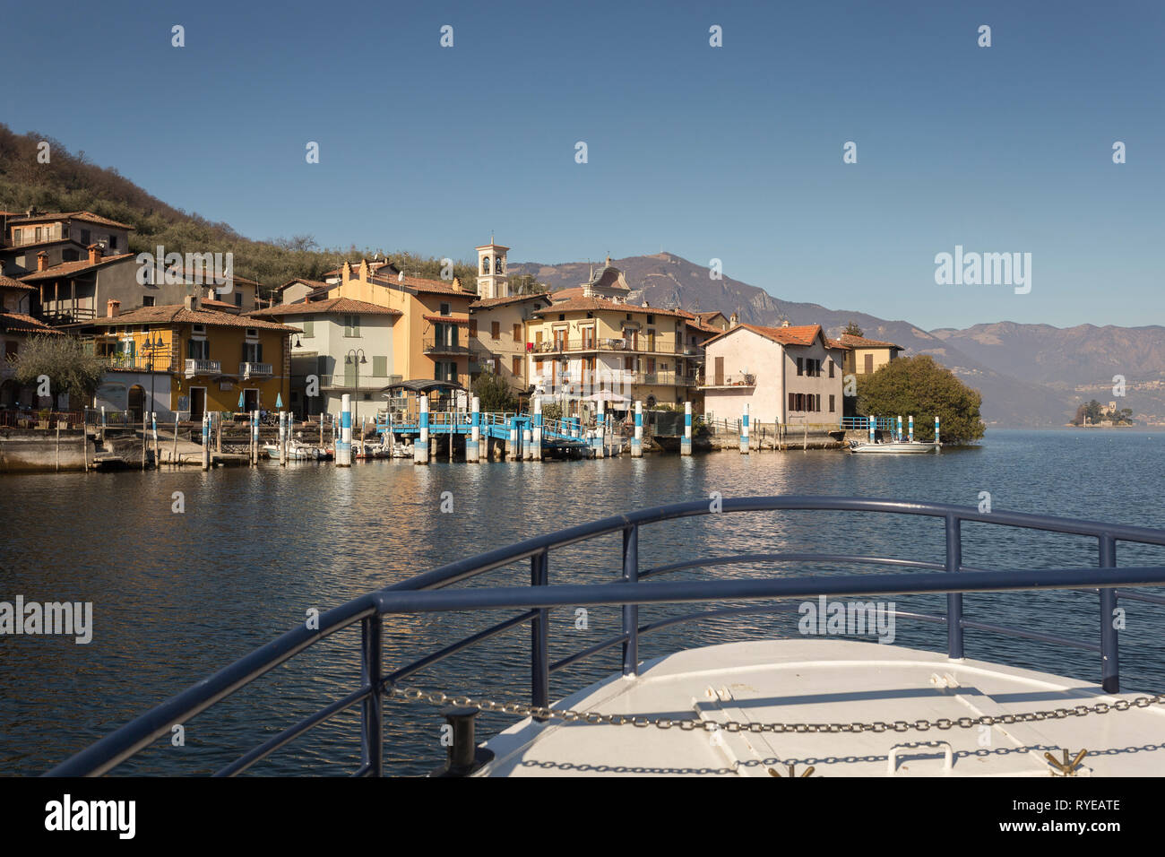 Ferryboat approaching Carzano on Monte Isola, Lombardy, Italy - Stock Image