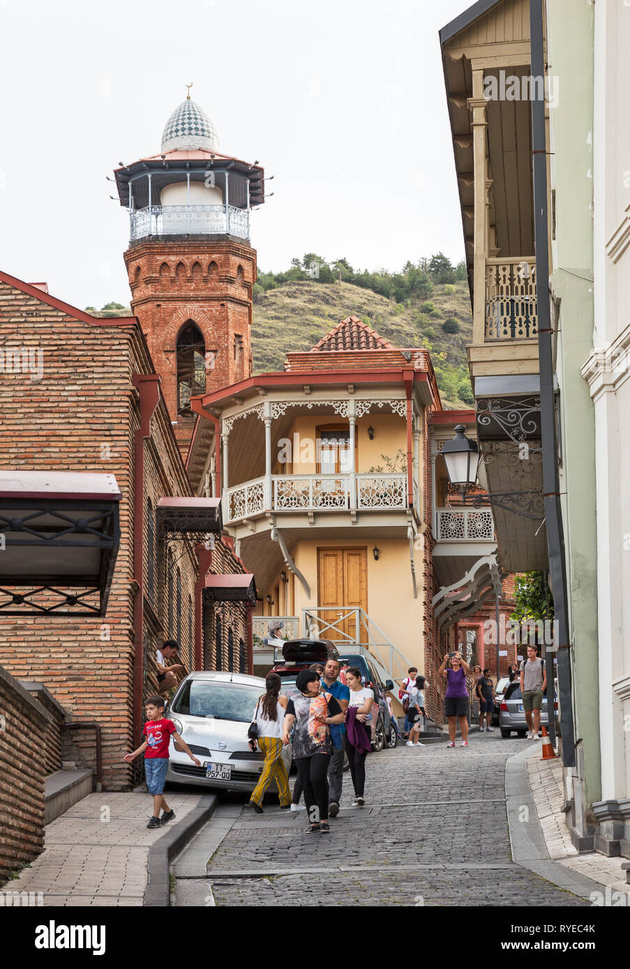 TBILISI, GEORGIA - SEPTEMBER 23, 2018: Many people, tourists and locals, walk on narrow streets of old town Tbilisi near the Juma mosque Stock Photo