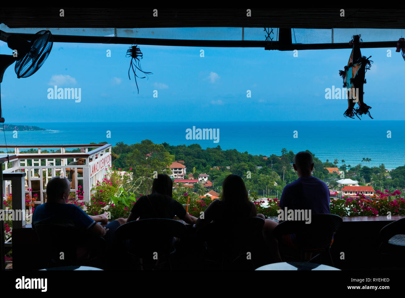Silhouettes of people relaxing in bar on observation deck Lamai view point, Samui, Thailand Stock Photo