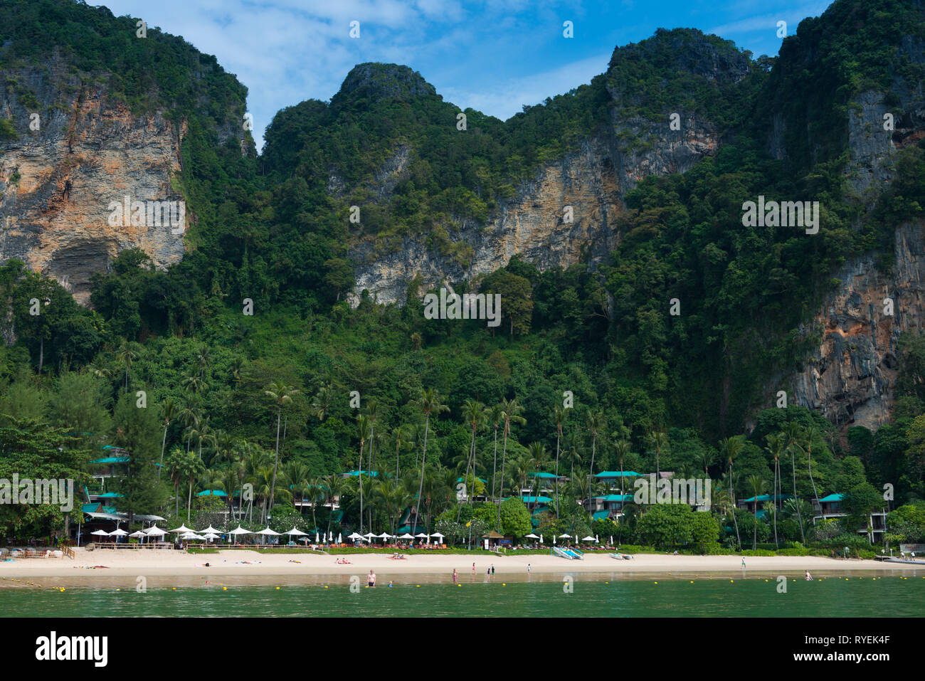 Panorama of Centara Grand Resort, limestone cliffs and beach near Ao Nang, Krabi province, Thailand - Stock Image