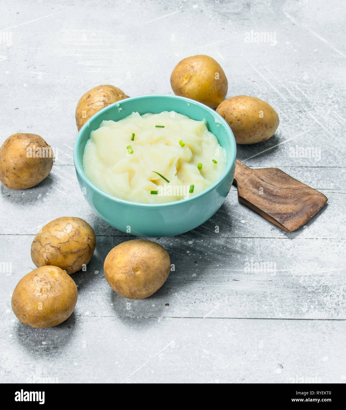 Mashed potatoes in a bowl . On a rustic background. - Stock Image
