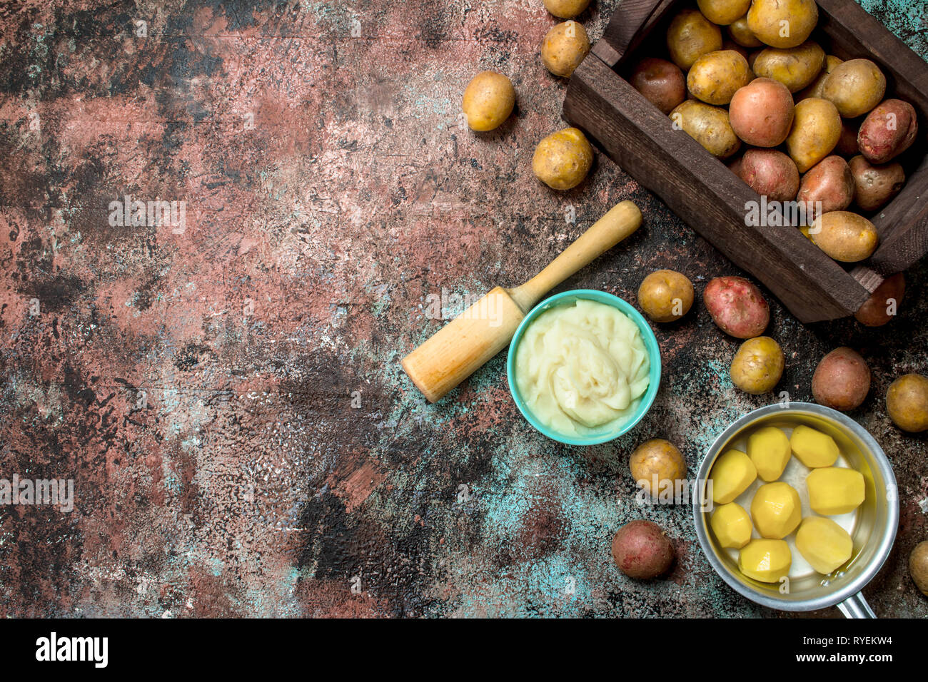 Mashed potatoes in a bowl. On a rustic background. - Stock Image