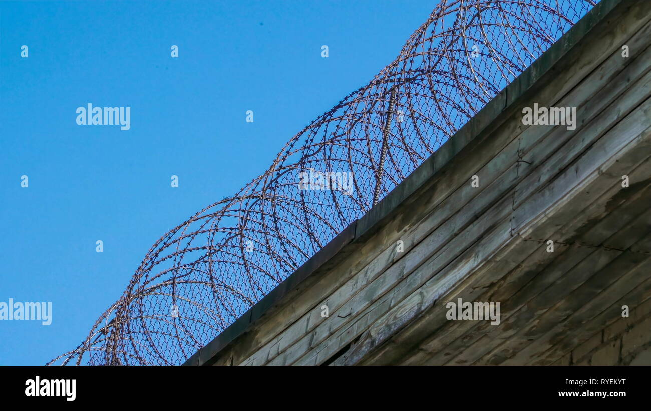 The barb wires of the fence in Patarei prison in Tallinn Estonia from the high wall of the building - Stock Image