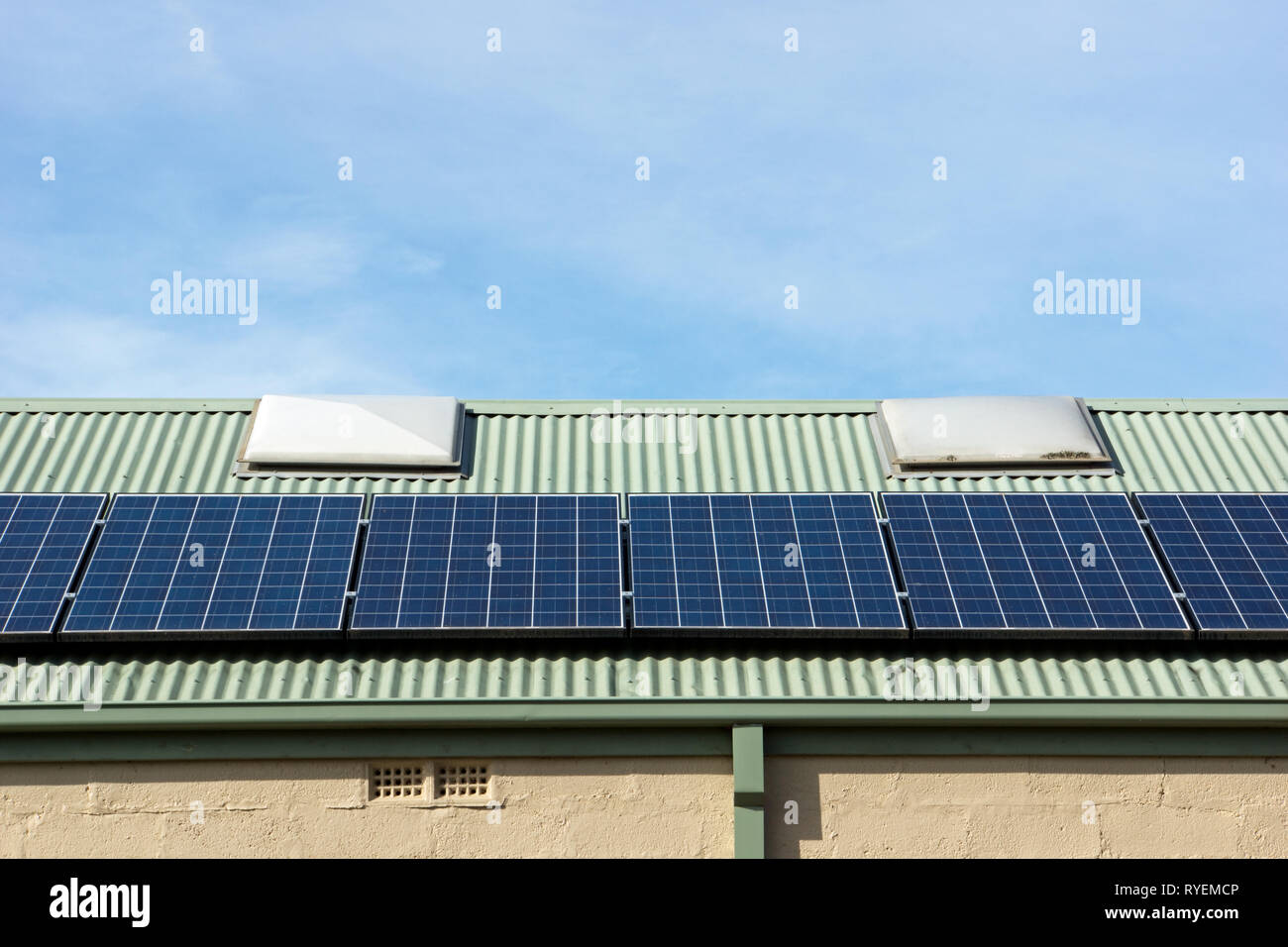Building solar panels on roof in Victoria, Australia. The photovoltaic cells are an alternative energy, sustainable resource. - Stock Image