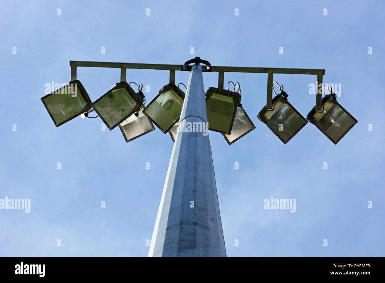 Stadium floodlight and lighting rig sits on top of a structural metal pylon, in Victoria, Australia. - Stock Image