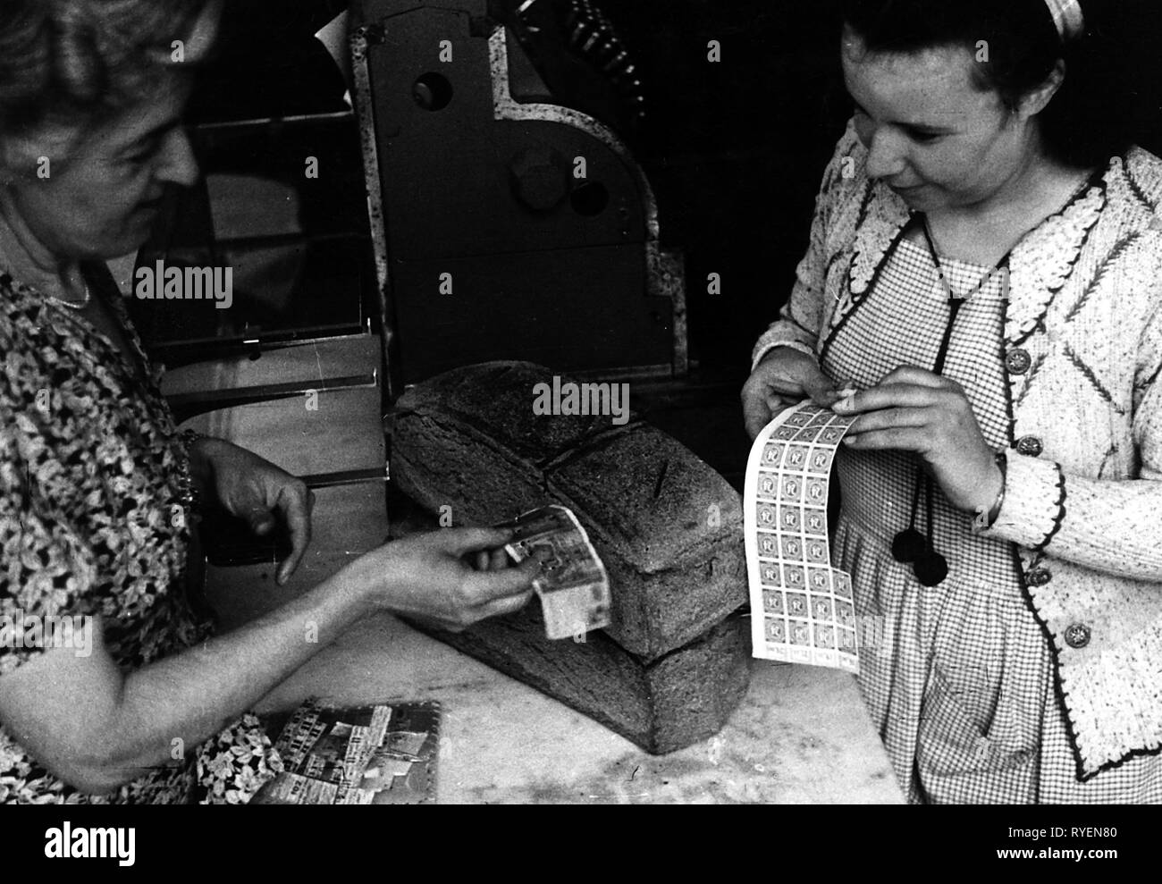 post war period, Germany, poverty, misery, lack of money, customer paying with stamps, Hamburg, 2.7.1947, Additional-Rights-Clearance-Info-Not-Available - Stock Image