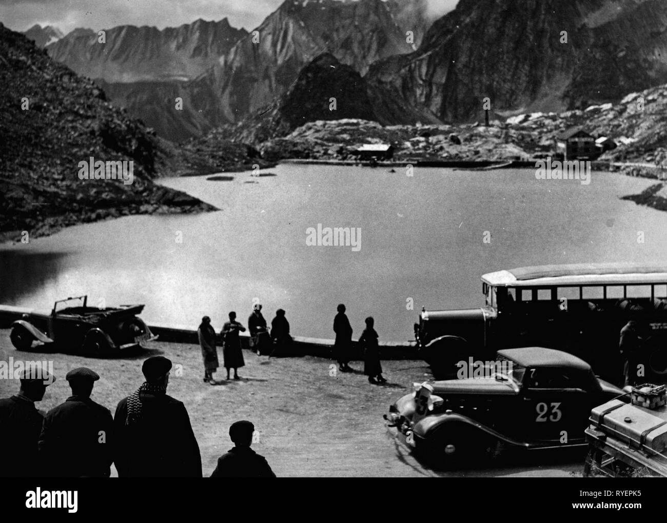sports, car racing, rally, 6th international Alpine Cruise, 7.8. - 12.8.1934, rest at the lake at Great Saint Bernard, in front of the Renault Vivasport of E. Negrel (France), Additional-Rights-Clearance-Info-Not-Available - Stock Image