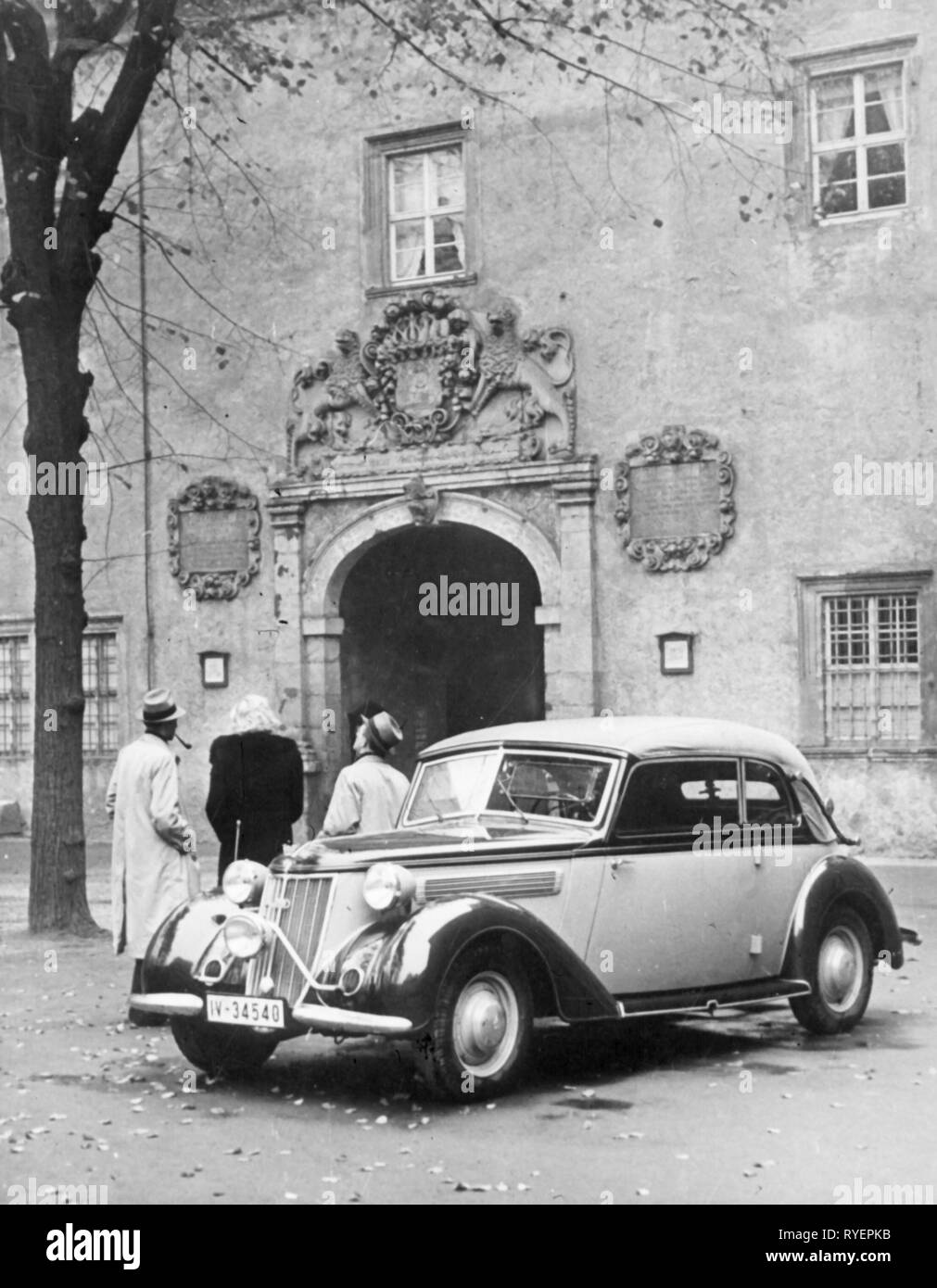 transport / transportation, car, vehicle variants, Wanderer W23, view from left ahead, Germany, 1938, serial number plate district Chemnitz, Saxony, W 23, headlamp, headlights, headlamps, round headlight, headlight, folding top, convertible top, folding tops, convertible tops, folding roof, folding roofs, convertible, cabriolet, convertibles, cabriolets, upper middle class, motor car, auto, automobile, passenger car, motorcar, motorcars, autos, automobiles, passenger cars, German, German Reich, 1930s, 30s, people, group, groups, 20th century, tra, Additional-Rights-Clearance-Info-Not-Available - Stock Image