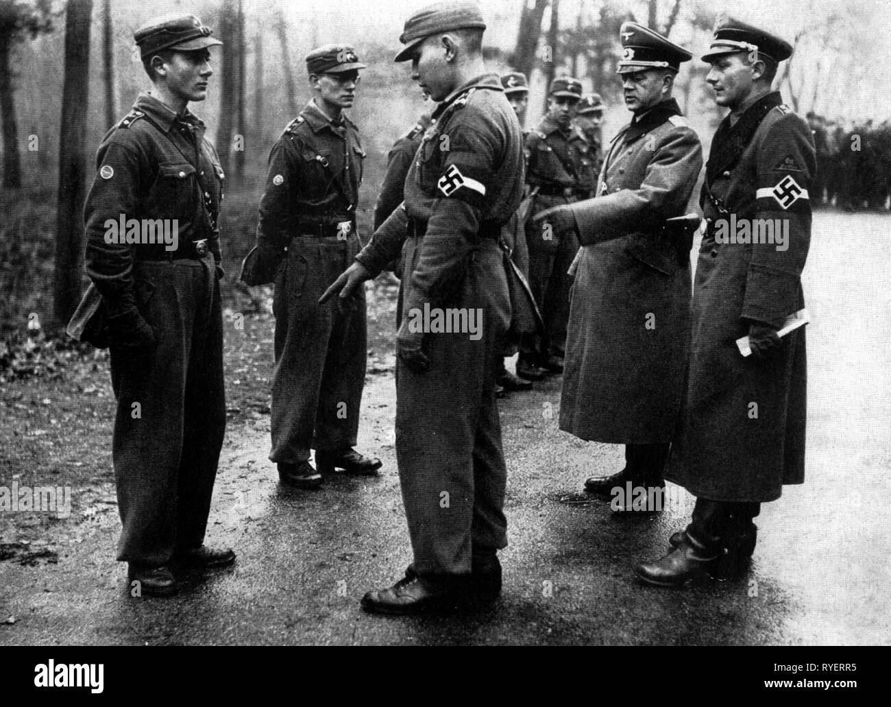 Nazism / National Socialism, organisations, Hitler Youth (HY), Hitler Youth member of the Hitler Youth District Berlin East during paramilitary training, inspection in the presence of an army officer, 1939, Additional-Rights-Clearance-Info-Not-Available - Stock Image