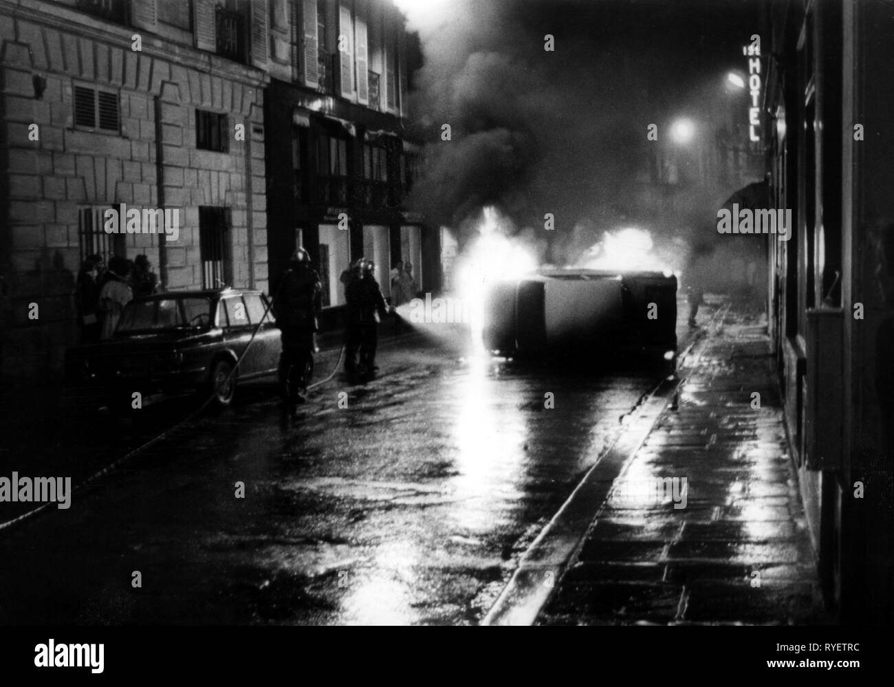 demonstration, France, 1968, student uprisings, in the Quartier Latin, fire brigade is dousing a burning car, 7.5.1968, Additional-Rights-Clearance-Info-Not-Available - Stock Image