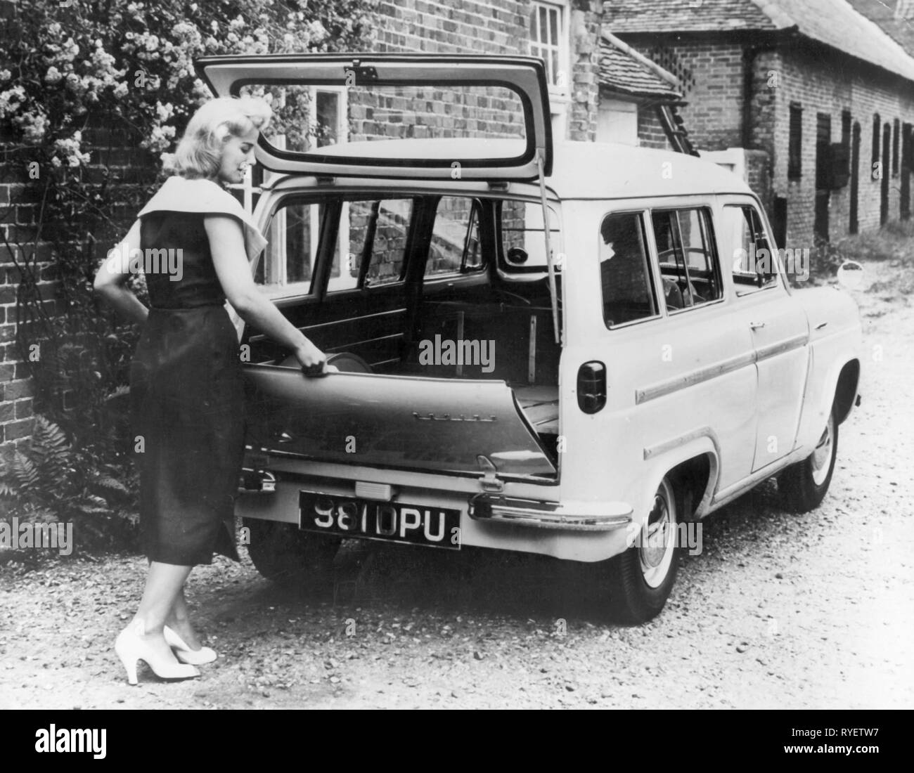 transport / transportation, car, vehicle variants, Ford Squire, young woman unbolting of the boot, Dagenham, Essex, England, 12.10.1955, Additional-Rights-Clearance-Info-Not-Available - Stock Image
