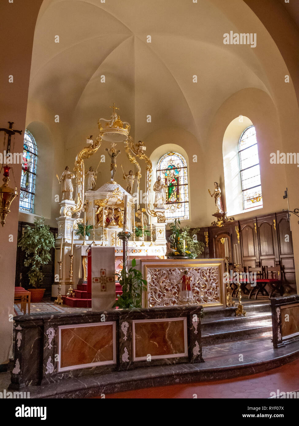 BURG-REULAND, BELGIUM - APRIL 01, 2013: Choir view with a canopy high altar at the Church of St. Stephen Stock Photo