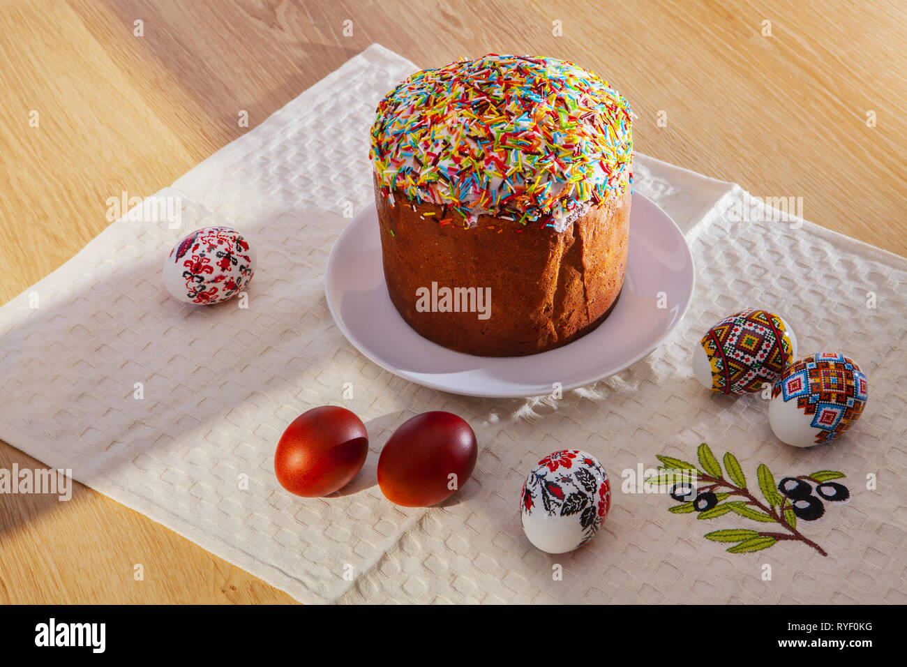 Painted Colorful Easter Eggs and egg bread - Stock Image