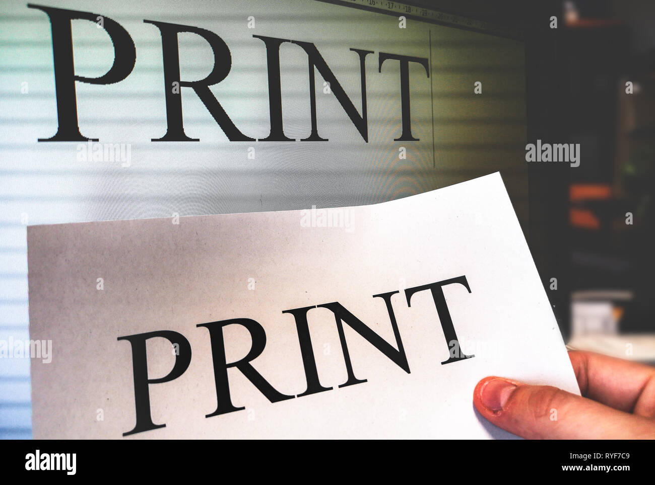 printer hand hold a print sheet with word processor software screen on background in office - Stock Image