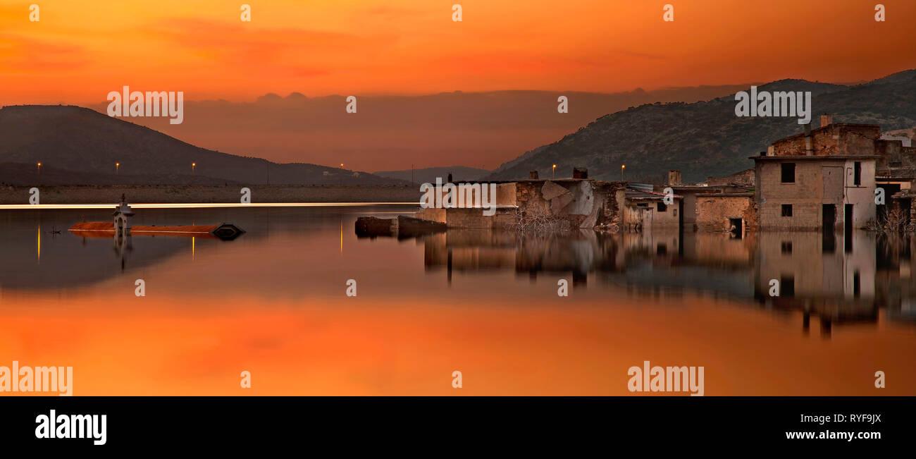 Sunset at the 'sunken' village of Sfendyli at the artificial lake of Aposelemis, Municipality of Hersonissos, Heraklion, Crete, Greece - Stock Image