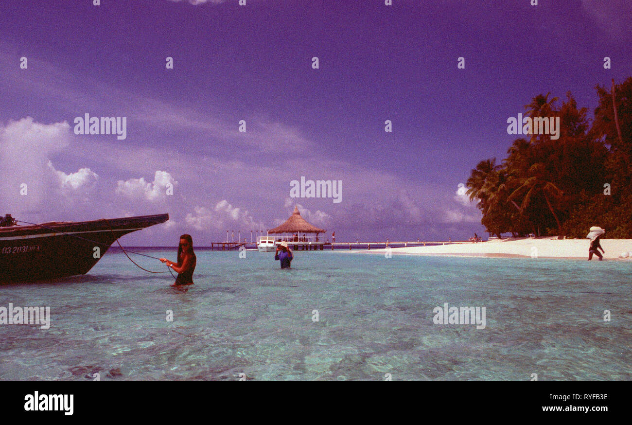 Endangered and disapearing islands and holiday paradies Maledives Islands. The sand bags are against the erosion du to the global climate change - Stock Image