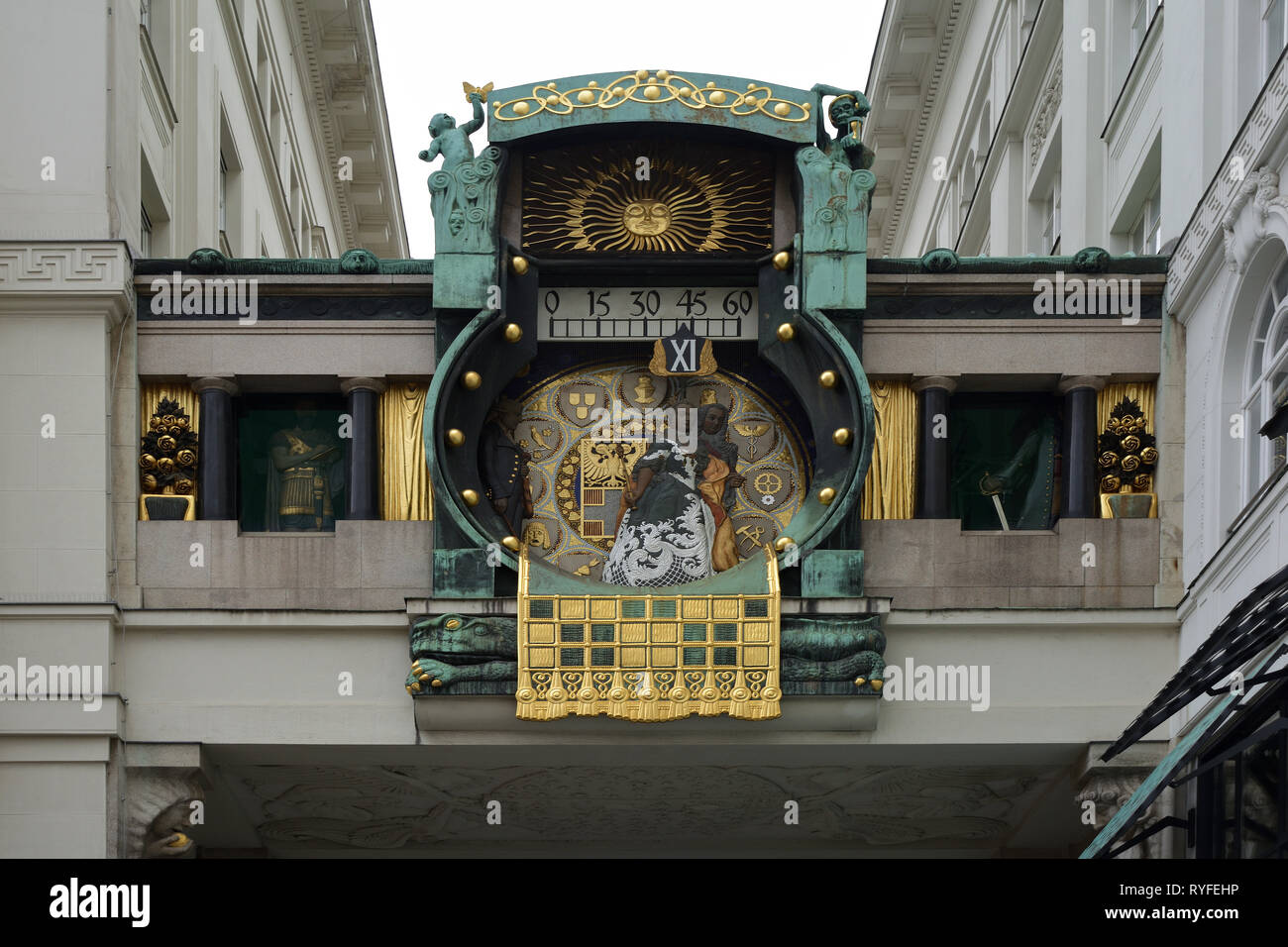 Art Nouveau game clock Ankeruhr from 1914 on the square Hoher Markt in the Austrian capital Vienna - Austria. Stock Photo