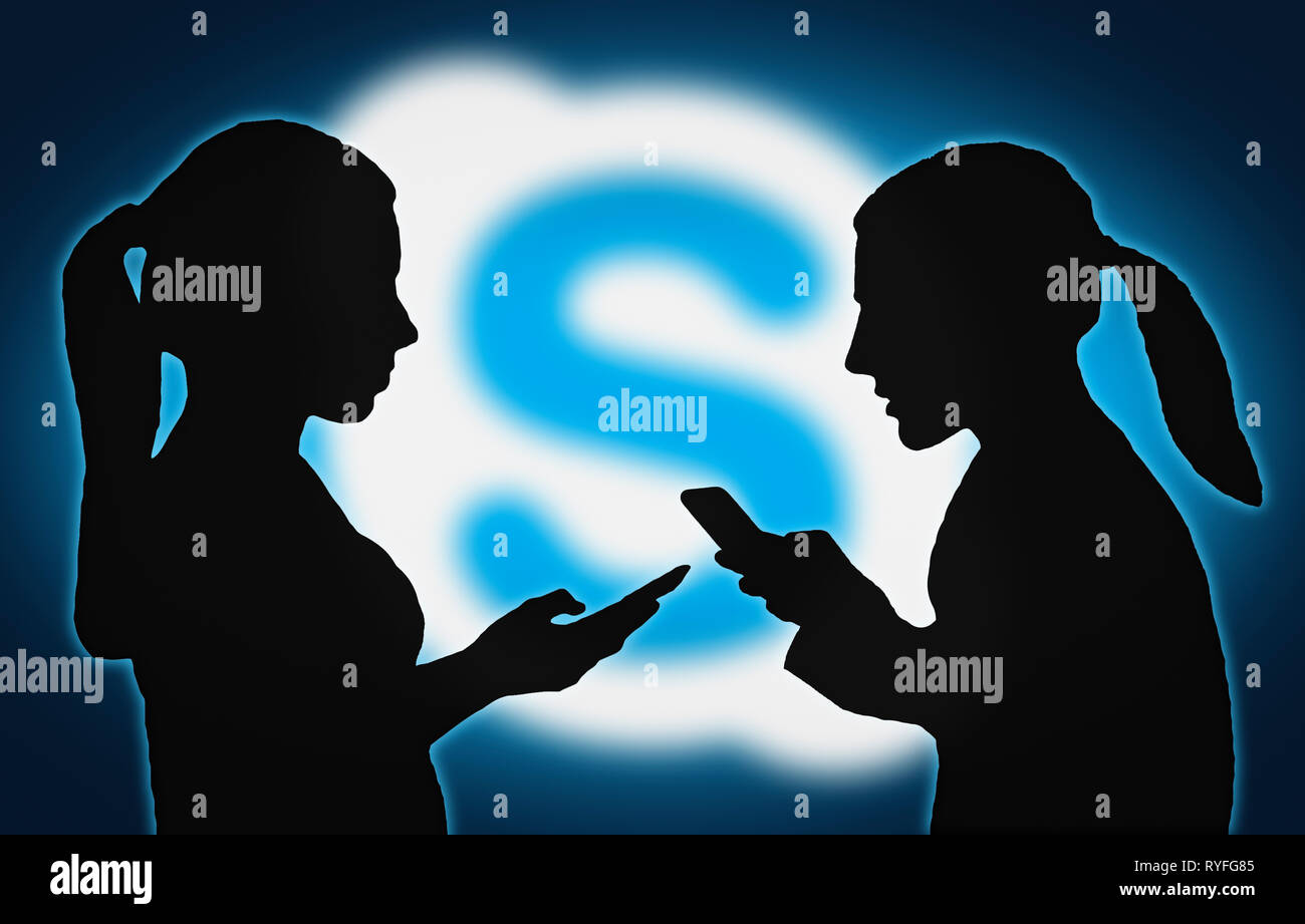 Silhouettes of group of people with mobile devices using the Skype app. - Stock Image