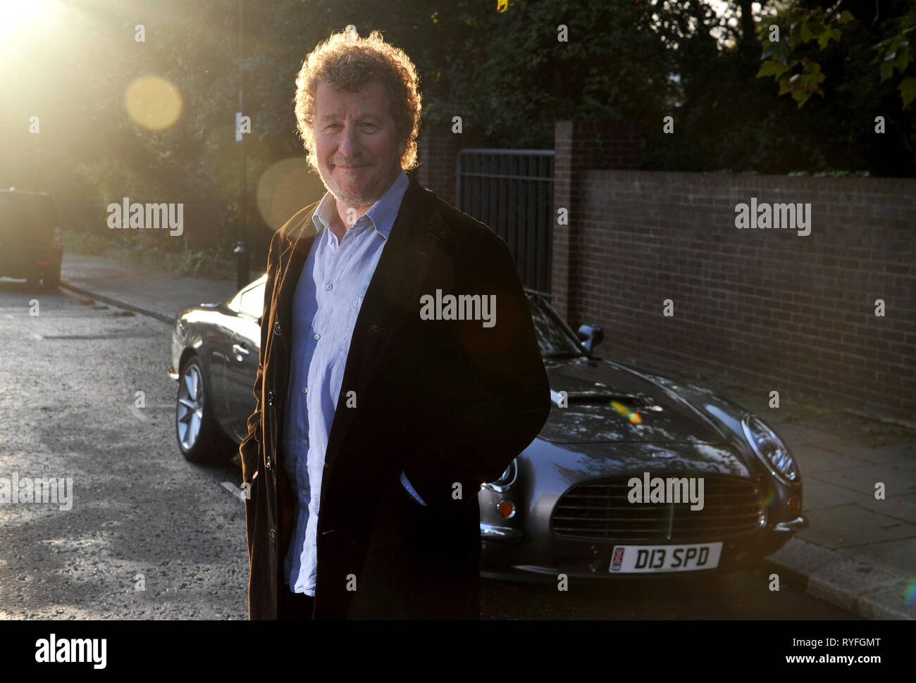 Author Sebastian Faulks with the David Brown Speedster car Stock Photo