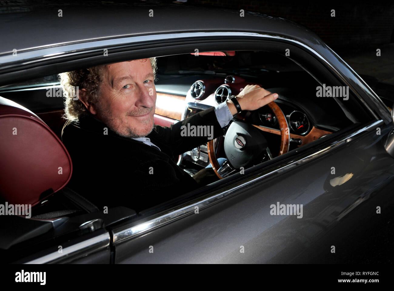 Author Sebastian Faulks with the David Brown Speedster car Stock Photo
